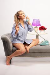 Woman talking on vintage phone