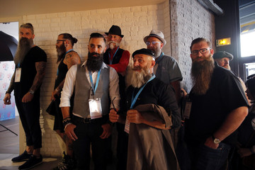 Competitors wait to have their picture taken prior to the competition during the French 2019 Beards Championship in Paris