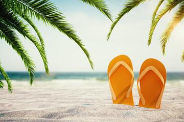 Orange flip flops on beach