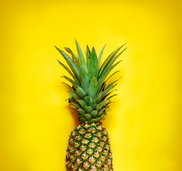 Fresh pineapple on yellow background