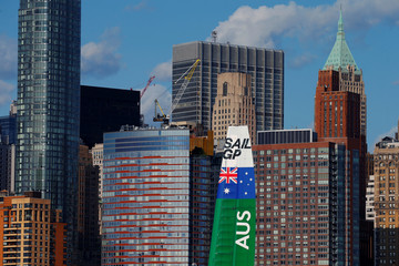 The wing of Team Australia's catamaran is seen in the skyline of New York during the second race of the second day of the SailGP event in New York