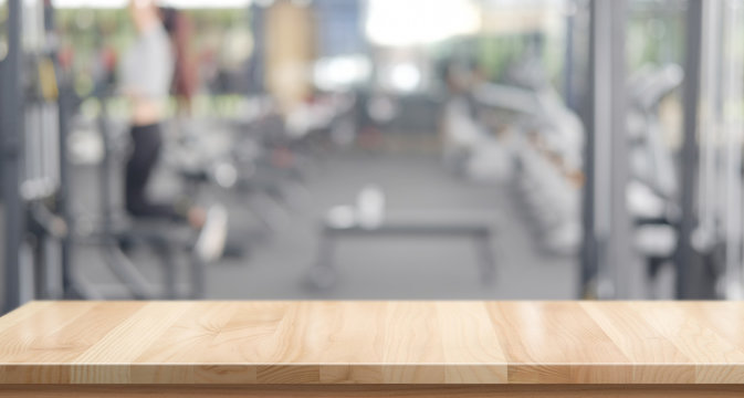 Empty wood table space platform and fitness gym background