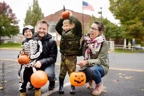Family with two children on traditional party for celebrations halloween near New York.