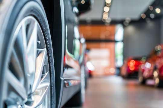 blur view of new modern car tire in showroom
