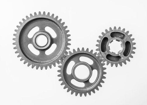 top view of 3 metal gear isolated on white