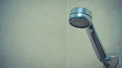 Drops of water from the damaged shower, leak water and rust on the shower tap. Royalty high-quality free stock video footage of damaged leaking water tap hose in the bathroom of house, flat or hotel