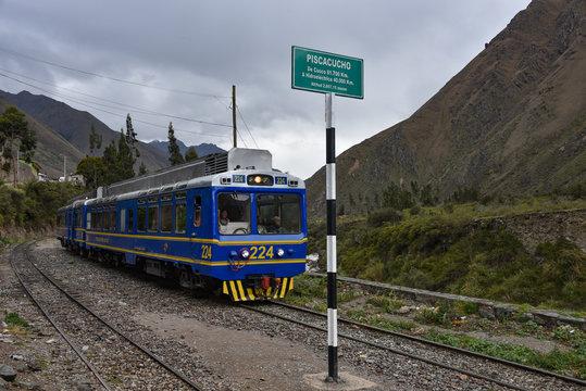 Cusco, Peru - Oct 15, 2019: A Peru Rail Expedition train travelling from Ollantaytambo to Machu Picchu