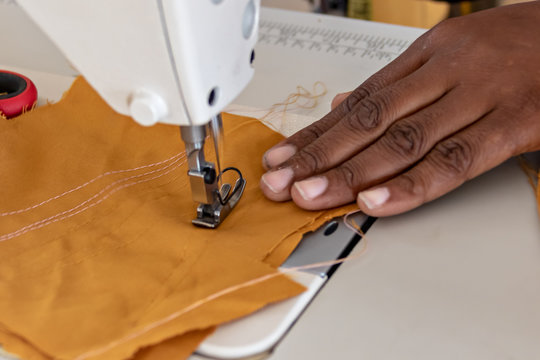 African hands sewing