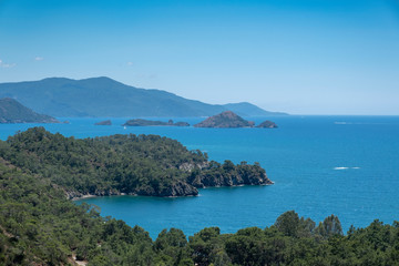 Meditation and fun in nature. Forest and beautiful sea in Mediterranean.