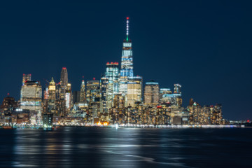Wall Mural - Scene of New york cityscape river side which location is lower manhattan which can see One world trade center at twilight time,USA,Taking from New Jersey,Architecture and building with tourist concept