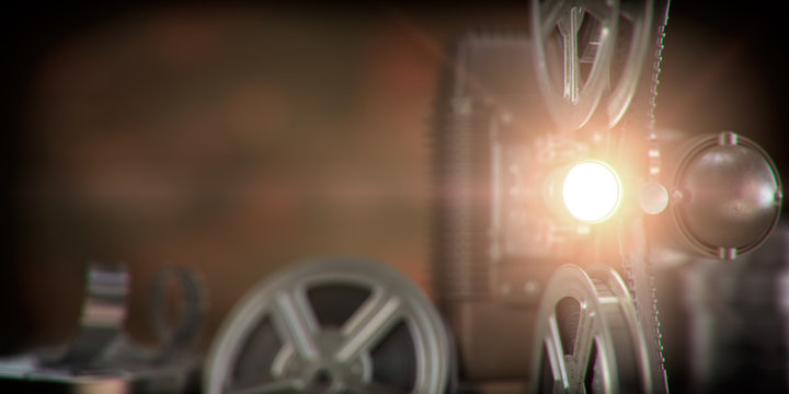 Movie projector with light beam and film reels on dark background. Cinema, movie, video retro vintage background.