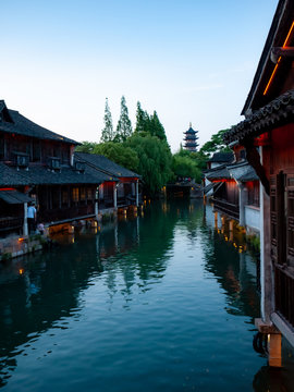 Wuzhen China, traditional houses sorrounding a water canal with reflection from the blue sky