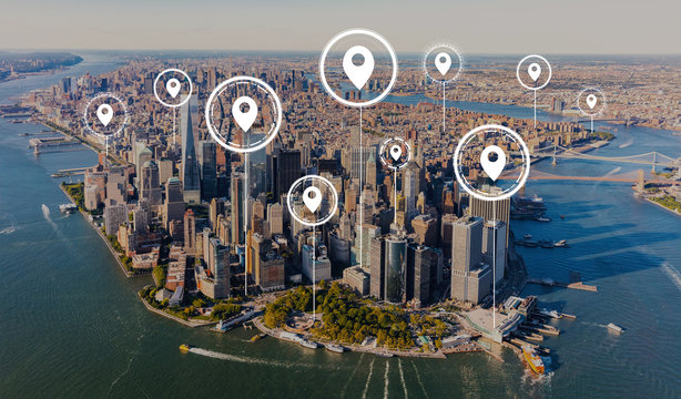 Map pins with aerial view of Manhattan, NY skyline