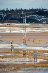 Airport runway lights and a beacon tower