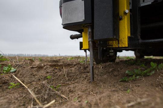 Soil Sampling. Automated probe for soil samples taking sample with soil probe sampler. Environmental protection, organic soil certification, research.