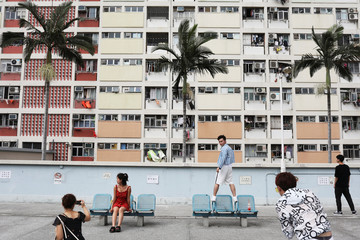 People take photo in front of Choi Hung estate, an apartment complex that became famous because of the rainbow color paints in Hong Kong