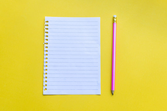 empty notebook with on yellow background.