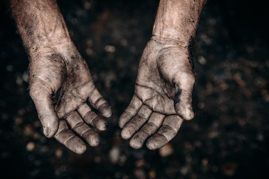 Dirty hands of worker miner are corns palms in abrasions. Concept hard work
