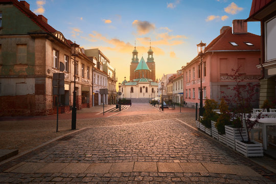 Historical road leading towards Gniezno Royal Cathedral on a sunset.