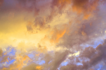 Colorful pastel clouds in the sky at sunset, dramatic clouds after a thunderstorm