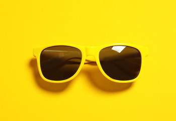Stylish sunglasses on color background, top view. Beach accessories Wall mural