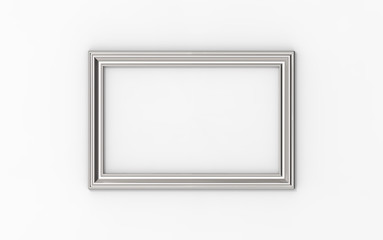 empty silver frame on the wall