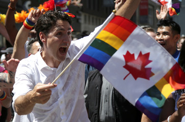 Canada's Prime Minister Justin Trudeau marches in one of North America's largest Pride parades, in Toronto