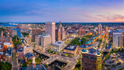 Fotomurales - Aerial panorama of Providence skyline at dusk. Providence is the capital city of the U.S. state of Rhode Island. Founded in 1636 is one of the oldest cities in USA.