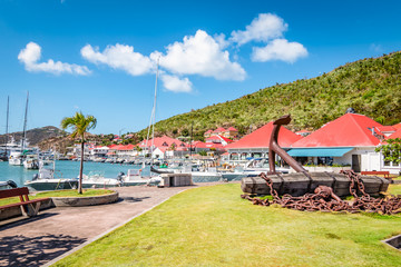 Wall Mural - Gustavia, harbor landscape with red rooftop buildings. Saint Barthelemy, St Barts, St Barths.