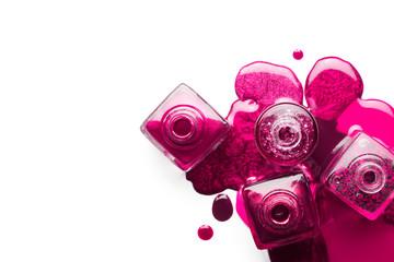 Nail art concept. Metallic pink nail polish