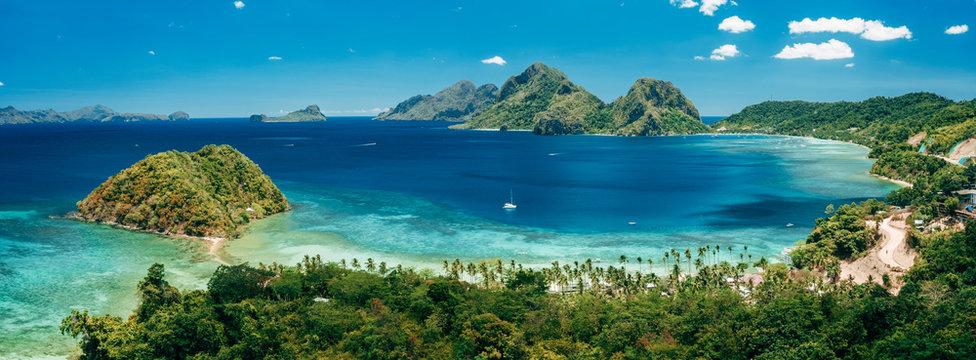 Aerial panoramic view of Las Cabanas beach and sea bay in El Nido, Palawan, Philippines