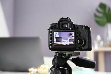 Photo of blogger's workplace on camera screen, closeup with space for text