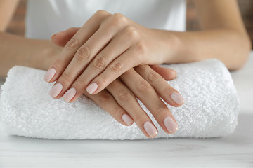Poster de jardin Manicure Woman showing smooth hands on towel, closeup. Spa treatment