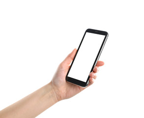 Woman holding smartphone with blank screen on white background, closeup of hand. Space for text