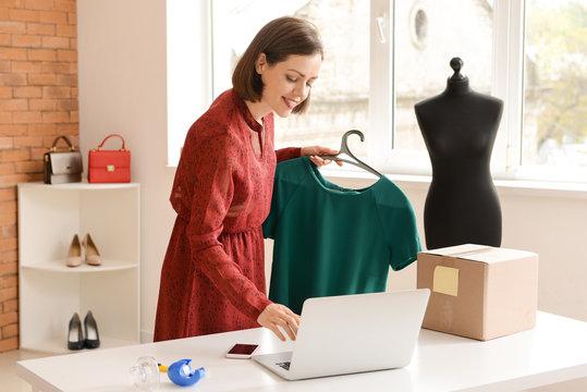 Female owner of online shopping site preparing order for client