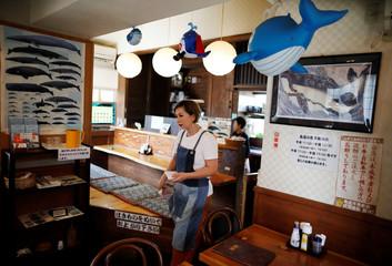 Yoko Ichihara takes order from customers at her restaurant named P-man in Minamiboso