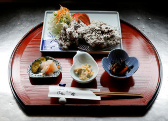 A set menu of deep-fried whale nuggets are prepared at the restaurant P-man in Minamiboso