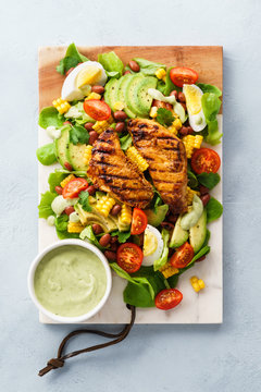 BBQ chicken cobb salad with avocado ranch dressing.
