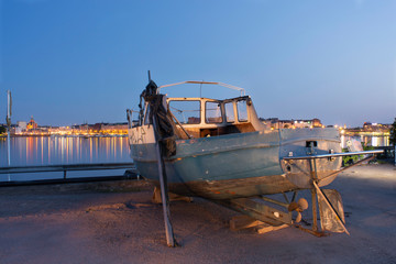 Abandoned boat waits for its final journey at old Sompasaari harbor