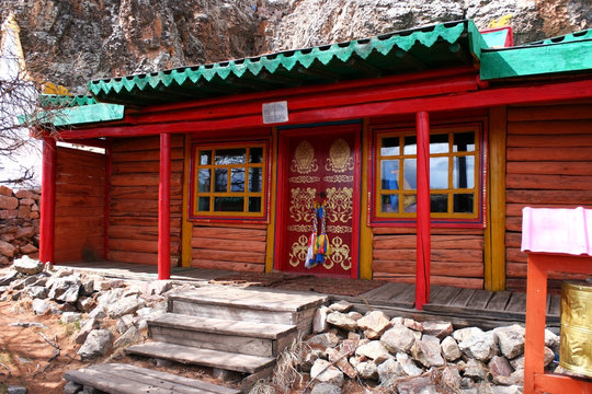 Building with painted traditional buddhist symbols red door in Tovkhon Monastery, Ovorkhangai Province, Mongolia. UNESCO World Heritage Site.