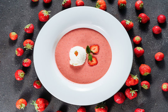 Strawberry Gazpacho Delicious Dish with Ice Cream. Cold Soup Dessert Made of Blended Natural Product and Decorated Slice Ripe Berries with Leaves. Refreshing and Cool Classic Portugal Cuisine Top View