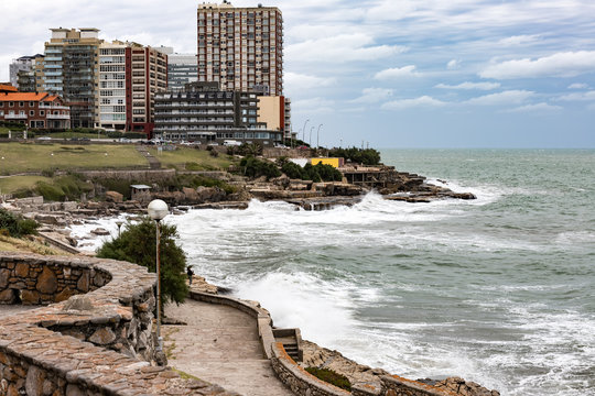 Panoramic of buildings facing the sea in Mar del Plata (Argentina) with wave breakers