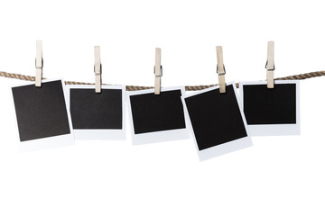 Blank pieces of paper and clothespins isolated on white
