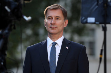 Conservative Party leadership candidate Jeremy Hunt attends an interview outside his home in London