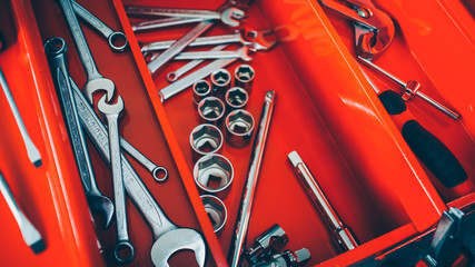 Mechanic workshop. Closeup of open professional toolbox with chrome wrench instruments.