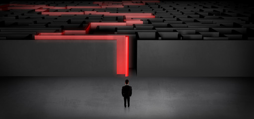 Wall Mural - Businessman getting ready to enter the dark labyrinth with stated road concept