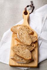 Sliced bread on cutting wooden board
