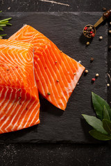 Salmon raw steak on slate