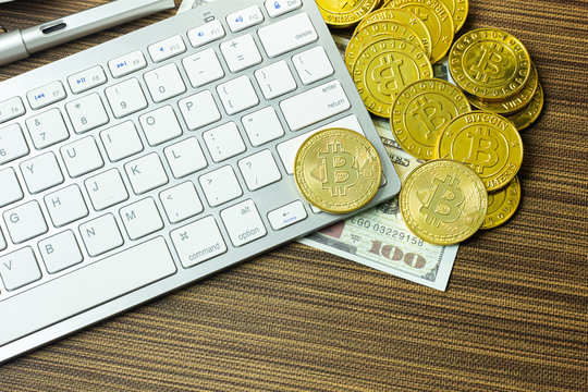 Bitcoin coin on silver keyboard for  cryptocurrency content.