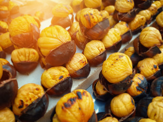 roasted sweet chestnuts on counter on street
